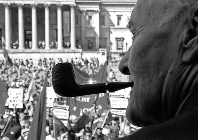 A Tony Benn's-eye view of Trafalgar Square full of crowds and banners.